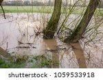 flooded river bank caused by... | Shutterstock . vector #1059533918