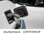 electric car refuel with power | Shutterstock . vector #1059534029
