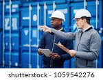 port manager and a colleague... | Shutterstock . vector #1059542276