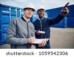 two smiling engineers wearing... | Shutterstock . vector #1059542306