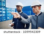 two engineers wearing hardhats... | Shutterstock . vector #1059542309