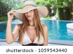 attractive sexy lady posing at... | Shutterstock . vector #1059543440