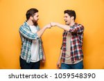 portrait of a two happy young... | Shutterstock . vector #1059548390