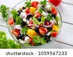 fresh vegetable salad with feta ... | Shutterstock . vector #1059567233
