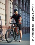 sporty guy cyclist in cycling... | Shutterstock . vector #1059569444