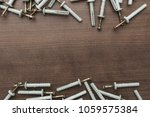 new dowels on the wooden table... | Shutterstock . vector #1059575384