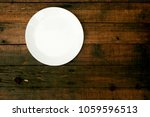 Empty White Plate On Wood...