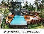 private tropical swimming pool... | Shutterstock . vector #1059613220