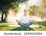 yoga at park. senior bearded... | Shutterstock . vector #1059634304