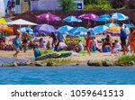 people swimming and enjoy... | Shutterstock . vector #1059641513