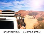 the roof of a white suv ... | Shutterstock . vector #1059651950