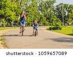 happy family is riding bikes... | Shutterstock . vector #1059657089