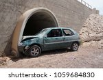 Small photo of Crushed car wreck in crash accident with fatal outcome