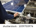 production of solar panels  man ... | Shutterstock . vector #1059703976
