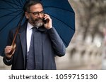 happy mid adult businessman...   Shutterstock . vector #1059715130