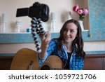young girl with acoustic guitar ... | Shutterstock . vector #1059721706
