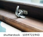 a metal window lock for wooden... | Shutterstock . vector #1059721943