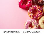 various donuts on pink pastel... | Shutterstock . vector #1059728234