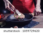 women's hands with tongs turn... | Shutterstock . vector #1059729620