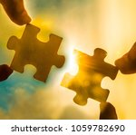two hands trying to connect... | Shutterstock . vector #1059782690