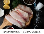 fresh fish fillet with... | Shutterstock . vector #1059790016