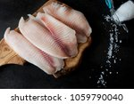 fresh fish fillet on the... | Shutterstock . vector #1059790040