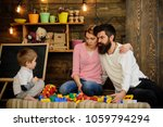 kid with parents play with... | Shutterstock . vector #1059794294