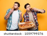two pleased men in shirt eating ... | Shutterstock . vector #1059799376