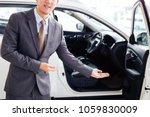 young chauffeur in business... | Shutterstock . vector #1059830009