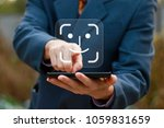 businessman presses button face ... | Shutterstock . vector #1059831659
