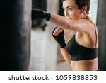 Small photo of close up cropped image of serious plucky athlete developing kickboxing skills. violent sport . reduce stress