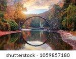 fantastic autumn landscape....   Shutterstock . vector #1059857180