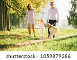 happy family with their dog in...   Shutterstock . vector #1059879386