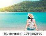 woman sitting on the beach   ... | Shutterstock . vector #1059882530