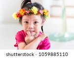 Small photo of Portrait of kid smiling with flower crown, Happiness time of life