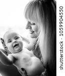 happy cute baby smiles on...   Shutterstock . vector #1059904550