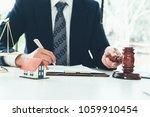 real estate law concept. gavel... | Shutterstock . vector #1059910454