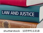 a book with the title law and... | Shutterstock . vector #1059911318