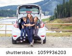 family traveling by car and... | Shutterstock . vector #1059936203