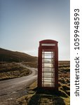 One Red Telephone Box By The...