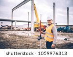 Surveyor Engineer Smiling With...