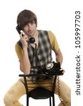 a young man with an old phone... | Shutterstock . vector #105997703