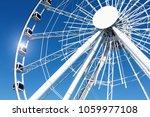 ferris wheel over a blue sky   Shutterstock . vector #1059977108