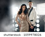 sensual couple on the club... | Shutterstock . vector #1059978026