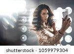 portrait of a brunette  elegant ... | Shutterstock . vector #1059979304