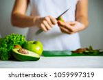 green fruits on front. woman... | Shutterstock . vector #1059997319