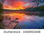 bright sunrise over forest lake | Shutterstock . vector #1060002608
