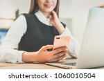 the woman phones near the... | Shutterstock . vector #1060010504