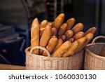 wicker basket full of baguettes ...   Shutterstock . vector #1060030130