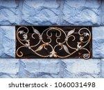 basement window with old lattice | Shutterstock . vector #1060031498